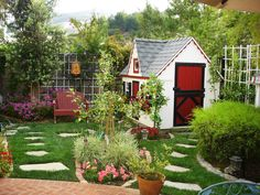 Colorful flowers and lots of steppingstones complete this playhouse garden.