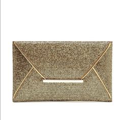 Glam Clutch These clutches will be a game changer to any alfit.   Brand new                                                        One gold and one bronze clutch with interior pocket. Bags Clutches & Wristlets
