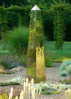 Stainless steel obelisk reflecting the landscape