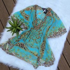 Beach Vibes Aqua Printed Kaftan Summery kaftan. Open sides. Similar to a poncho. Sheer. Lace up neckline with rhinestone embellishments. Super cute! Would go really well over a bathing suit at the beach or next to the pool. Or wear with shorts and a tank! Bundle & Save!  Made in China. PRICE IS FIRM! posh on first boutique Tops
