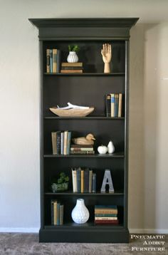 How to upgrade boring bookshelves with some 2 x 4's, molding and paint. www.pneumaticaddict.com
