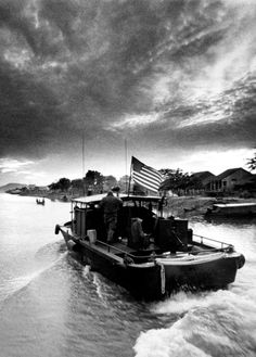 A river patrol boat heads into the rising sun after a night on ambush in South Vietnam's Mekong Delta in September, 1969. The 31-foot, 27-knot, heavily-armed U.S. Navy boats built on fiberglass pleasure craft hulls worked in groups of two and four on 24- to 48-hour missions in search of the Viet Cong. (Jim Falk/Stars and Stripes)