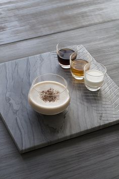 Brandy Alexander: equal parts brandy, dark creme de cacao, and cream. Shake over ice, strain and serve