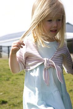 Organic cotton shrug in lavender/natural stripe. Sizes 18/24 mos. to youth 10.