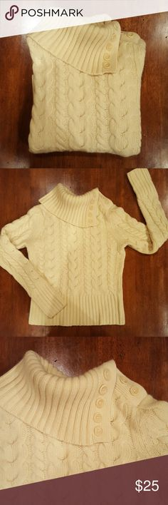 Pale yellow chunky knit sweater Ivory/pale yellow sweater. Cable knit, long sleeve, foldover cowl neck/turtleneck sweater. Buttons on left shoulder and left side of neck. Angora/lambswool blend. Banana Republic Sweaters Cowl & Turtlenecks