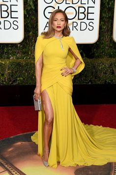 Leave it  Jennifer Lopez to make a bold statement on the Golden Globes red carpet. The superstar struck a pose on the red carpet in a striking yellow  Giambattista Valli gown complete with a cape at the 2016 Golden Globes on Jan. 10, 2016.