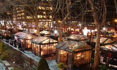 Twinkling shops at the holiday market in Bryant Park. Image by Bryant Park Corperation