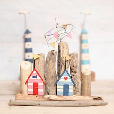 Driftwood Beach Huts ~ tabletop ornament of miniature seaside bathing huts hand-painted in bright colors, with a backdrop of natural driftwood, $18.33 ~ #coastal #nautical | by Red Berry Apple via Not on the High Street