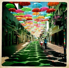 "Flickr photographer Patrícia Almeida recently shot these great photos of a wonderfully whimsical umbrella installation using her iPhone and camera. Like something out of a fairy tale, the umbrellas look almost like they're magically floating in mid-air. As she writes, ""In July, in Águeda (a Portuguese town), some streets are decorated with colorful umbrellas. I felt like a kid, amazed by all that color!"" She calls it Umbrella Sky."