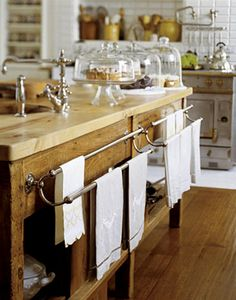 Gorgeous Island with towel racks and dessert stands #kitchen