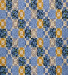 Join two-color blocks and setting rectangles to form a quilt top with a chain design.