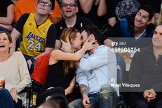 Adam Levine and Behati Prinsloo kiss at a basketball game between the Denver Nuggets and the Los Angeles Lakers at Staples Center on November 2014 in Los Angeles, California. Get premium, high resolution news photos at Getty Images Adam And Behati, Behati Prinsloo, Perfect Love, Basketball Games, Adam Levine, Maroon 5, Los Angeles Lakers, Kiss, Cinema