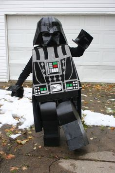 This is a 100% home-made LEGO Darth Vader costume, created using cardboard, papier mache, and spray paint. I bought a LEGO Darth Vader keychain from the LEGO store...