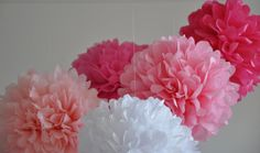 Tissue paper pom poms-Since finding this on Pinterest, I've made for so many themes, showers and birthdays.  Way easy and way inexpensive! Lay our 8-10 sheets of tissue, cut into 4ths (10x10 in squares).  That has worked the best for me!