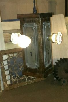 Illuminated Entrances – the glow of history, and the touch of time. Vintage crystal doorknobs, mounted on authentic backplates and distressed hardwoods... illuminated by up-to-date low voltage technologies. Available in soft, golden incandescent or vibrant LED. Repurposed in a novel reconfiguration as either a striking pendant fixture or a tabletop lamp. Available for purchase from the new workshops of Jack Riley Lighting and Metalworks. Contact us via email at JackRileyLighting@yahoo.com