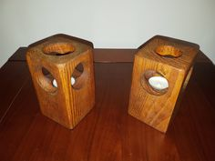 A pair of handcrafted wooden candle holders (tea lights)