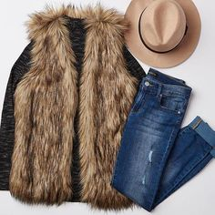 Cold? Not fur long.   Wear your fur vest with a mock turtle neck and distressed denim.