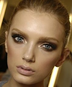 Great smokey eye for blondes with blue eyes and fair skin. I always feel like a hooker with a black smokey eye.