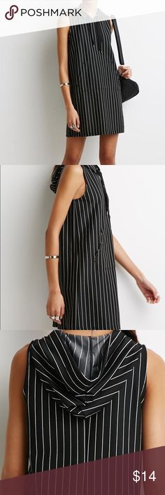 Pinstriped hoodie dress Pre owned/ good condition/ size large/ black/ white/ perfect for winter and spring Forever 21 Dresses Mini