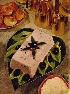 Luncheon Salad Loaf,guarded by an army of shiny black olives and a massive bowl of mayonnaise.  This makes olive loaf from the deli counter look good.  (1952)