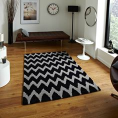 Hong Kong Black Grey Rug By Think Rugs Hong Kong Black Grey Rug which is an offering from Think Rugs, is a brilliant home décor accessory featuring modern zigzag patterns in two sophisticated colours of grey and black. Bedding Shop, Linen Bedding, Bed Linen, Black And Grey Rugs, Chevron Rugs, Striped Rug, Hand Tufted Rugs, Bath Linens, Modern Retro