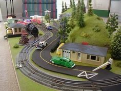 """MINI-THINGS 3' X 6' O SCALE PHOTO GALLERY Very basic O gauge layout using a 32""""x80"""" hollow-core door. Built for play!"""