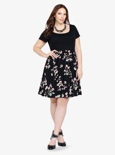 We've added a floral skirt to this texture-mixing t-shirt dress. The black knit bodice is soft and stretchy while the flower-blooming black challis skirt is light and flowy. And did we mention the pockets? We love this dress.