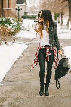 black leathery skinny pants, boots, jacket, and red plaid wrapped around waist.