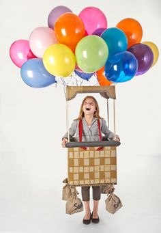 Colorful helium balloons help this cheery number hit new heights. Complete How-To: Hot Air Balloon Costume   - CountryLiving.com