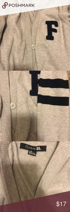 Forever 21 Varsity sweater cardigan size large Forever 21 varsity letter cardigan size large just bough randomly cuz I loved but I'm not a large at all :( .... gray and Navy blue worn once Forever 21 Sweaters Cardigans