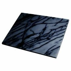 "Crafted from black marble, this alluring pastry board is the perfect surface for rolling out pie crusts or kneading bread dough.   Product: Pastry boardConstruction Material: MarbleColor: BlackDimensions: 1"" H x 15.88"" W x 12"" D"