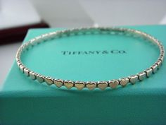 Tiffany & Co Paloma Picasso Sterling Silver Crown of Hearts Bangle Bracelet. #TiffanyCo #Bangle