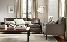 Pretty Neutral Living Room - Room & Board catalog (brown leather sofa, grey armchair, silver lamp, neutral drapes, wall & rug)
