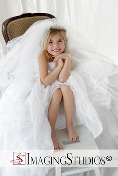 I wish I had thought of this!!    take your daughters picture in your wedding dress!