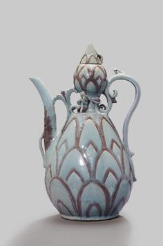The celadon (or greenware) ceramics produced in ancient Korea during the Goryeo Dynasty CE), are regarded as some of the finest and most elegant pottery. Korean Pottery, Dragon Fish, Mythical Dragons, Tea Cart, Antique Pottery, Korean Art, Art Object, Tea Pots, Cool Art