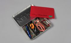 Men's fashion week S/S 2013 show invitations - Kenzo sent out this tin box containing a mini survival kit for the great outdoors - a cryptic nod to the jungle-inspired collection revealed at the show