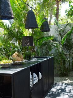 July/August 2014 An outdoor kitchen with hanging woven string lights.