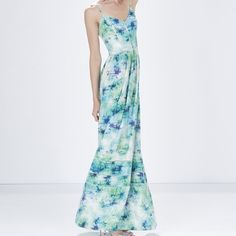 HPParker - Printed Maxi Dress Green printed multicolor. This perfect flowy summer dress is intricately detailed with a colorful print & ladder stitch inset. Fitted bodice features adjustable straps and a smocked back for a great fit. Finished in a maxi length, gentle pleat skirt. 100% silk. Imported. Dry clean only. Color: Pompano. Good condition! Only imperfection is that the actual brand tag is only half stitched on now. Can easily be fixed or just cut off completely. Make me an offer…
