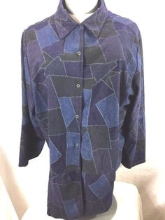 "Options by Delta Burke. Purple, Blue, Black Geometric Pattern. Long Sleeve Snap Up Blouse. Slits on each side at bottom. The first picture is more true to color. Length 30"". Has a quality feel. 