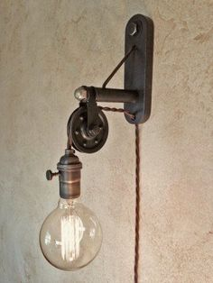 Industrial Pulley Sconce Lamp. Plug in. by IroncladIndustrial