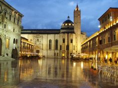 Piazza del Popolo, Ascoli Piceno, Italy. The entrance to our apartment building is where this picture was taken from. TAKE ME BACK