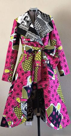 African Print Patchwork Reversible Coat Dress high low With Pockets and Tie Belt 100% Cotton Black White Pink Yellow. This is a stylish and easy to wear piece with great versatility. It can be worn over jeans or a skirt, leggings or a dress. Ankara | Dutch wax | Kente | Kitenge | Dashiki | African print bomber jacket | African fashion | Ankara bomber jacket | African prints | Nigerian style | Ghanaian fashion | Senegal fashion | Kenya fashion | Nigerian fashion | Ankara crop top (affiliate)
