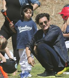 Father-son time: Orlando Bloom supported his adorable son Flynn at his Little League Yanke...