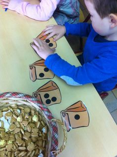 Bags with numbers on them - have kids count out that number of items (candy? toys? coins?) for each bag