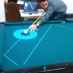 PoolLiveAid, a new projector designed by students in Portugal, lets you digitally line up your billiard shots.