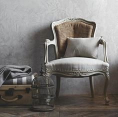 Gray textured walls and chair