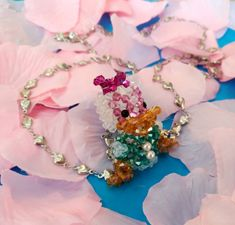 Handmade necklace with: -Daisy Duck pendant made with crystal bicones -chain with hearts.