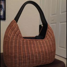 Wicker handbag Cute handbag from Barr + Barr. Wicker with a black leather handle. Inside drawstring pouch made of dark denim. Really cute. Light wear on handle. Barr + Barr Bags