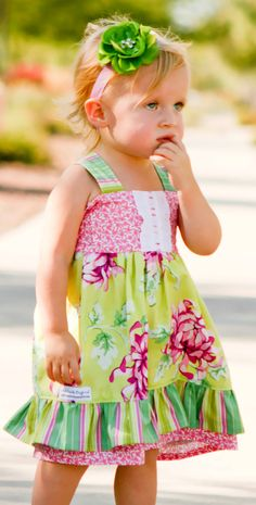 This adorable all-season dress is sure to be an eye-catcher! It is perfect for events, parties, pictures, and play! It has adjustable straps and a fully shirred back for plenty of growing room to last her a long time!