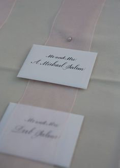 White Escort Cards with Calligraphy